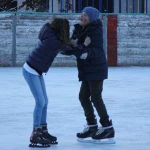 Happy children skating on Deliv Rent skating rink